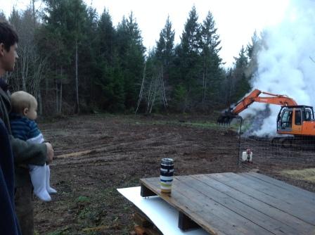 Watching John restack the burn pile
